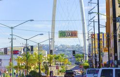 Monumental arch, Tijuana, Mexico. The Millennial Arch (Arco y Reloj Monumental), a metallic steel arch at the entrance of the city of Tijuana in Mexico, at zona Stock Photo