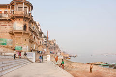 Monumental buildings under riverboats on sacred river Ganges Stock Photo