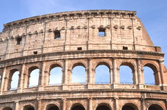 Monumental Colosseum in Rome against blue sky, Italy Royalty Free Stock Images