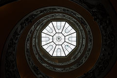 The monumental double spiral staircase. Rome, Italy - March 1, 2013: The monumental double spiral staircase designed by Giuseppe Momo helical to the Vatican Stock Photo