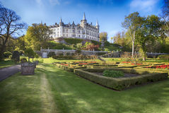 Dunrobin Castle, Scotland. Spring sunny day in the park. The monumental Dunrobin Castle at the southeast coast of Scotland, Europe, with it's wonderful english Royalty Free Stock Photos