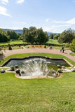 Monumental fountain with waterfalls in a French city park Royalty Free Stock Photo