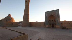 Monumental gates of the Poi Kalon Mosque and Minaret in Bukhara, Uzbekistan stock footage