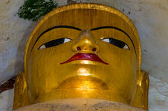 Monumental golden Buddha Face Portrait in old Temple Royalty Free Stock Photos
