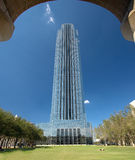 Monumental office tower in park stock photo