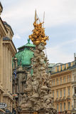 Monumental Plague column. VIENNA, AUSTRIA - JUNE 27, 2015: Monumental Plague column (Pestsaule) on Graben street. The Graben is one of the most famous streets in Royalty Free Stock Photography