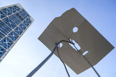 Monumental sculpture, David y Goliat, by Antoni Llena, and tower Hotel Arts, next to Olympic Port, Barcelona. Stock Image