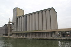 Monumental silos. Monumental concrete silo building next to dock Stock Photo