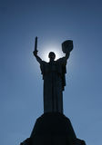 Monumental statue of the «Mother Motherland» with solar halo a Royalty Free Stock Image