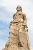Monumento aos Mortos da I Grande Guerra Maputo Mozambique. Statue of a woman with a sword and shield on one side and a serpent on the other, erected to Royalty Free Stock Photography