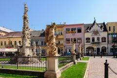 Monumento da coluna do praga e Beggar' casa de s imagem de stock