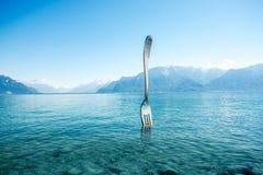 Monumento de la bifurcación en el lago geneva Fotografía de archivo