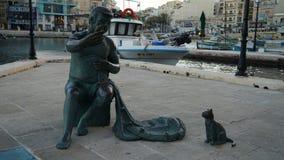Monumento del pescatore, baia di Spinola, st Julians, Malta fotografia stock libera da diritti