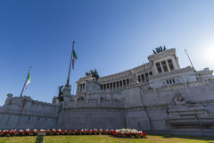 Monumento Nazionale Rome. Sunny day with a blue sky and Italian flags Stock Images