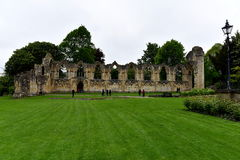Monuments, ruins. Ancient baths in York, monuments, ruins residue walls of the church, history, seeing sights, learning, leisure time, green grass, lantern Stock Photo