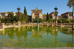 Monuments of Seville in Park Maria Luisa. Historic buildings of Archaeological Museum i Maria Luisa Park (Botanic garden) - Plaza de America, Seville, Andalusia Royalty Free Stock Images