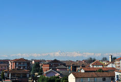 Monviso mountain in Piedmont Italy. Small town against snow-capp Stock Photo