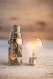 Mony coin in bottle.jpg. Mony coin in bottle with glow light bulb business cocnept.jpg Stock Photography