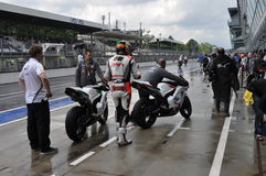 Monza 2012 - Getting on the bike at the paddock Royalty Free Stock Photos