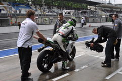 Monza 2012 - Getting on the bike at the paddock Stock Photography