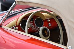 Vintage supercar interior. MONZA, ITALY - MAY 19 : classic car interior with close-up on steering wheel. Car in old racing car in rally `Mille Miglia` 2018 the Royalty Free Stock Images