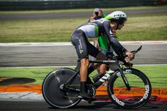 Monza, Italy May 28, 2017: Professional cyclist, Dimention Data TEAM, during the last time trial stage of the Tour of Italy 2017. With a lap of the Formula 1 Stock Photos