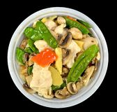 Moo Goo Gai Pan. In a bowl on a black background Stock Photos