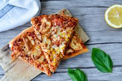 Chicken Pizza. Mood shoot of an italian chicken pizza and ,fresh basil royalty free stock photo