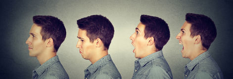 Mood swing. Man with different emotions face expressions. Mood swing. Young man with different emotions face expressions royalty free stock photo