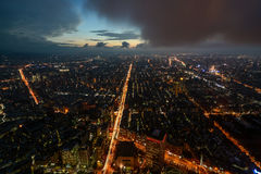 Moody aerial night view of city lights across Taipei, Taiwan just after sunset Stock Image