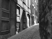 Moody alleyway. An atmospheric side-street in Parma, Italy Stock Image
