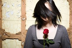 Moody asian female holding rose Stock Photography
