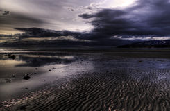 Moody beach in evening Royalty Free Stock Photography