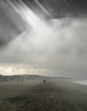 Moody beach with fog Stock Photography
