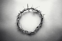 Crown of Thorns in Black and White. Moody black and white image of crown of thorns like Jesus Christ wore with drops of blood on tips of thorns over grunge royalty free stock photography