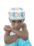 Moody boy wearing a traditional hat, five years old Stock Photos