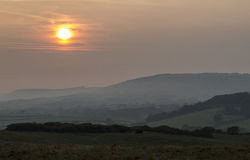 Moody and calming sunset over Corfe Common Stock Image