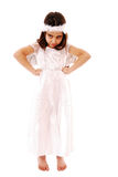 Moody child. Portrait of young girl having a temper tantrum camera dressed in fancy dress Stock Photo