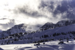 Moody clouds high in the snowy mountains Stock Photography