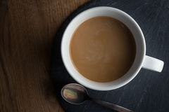 Moody coffee cup. On wooden table Royalty Free Stock Photo