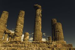 Moody columns. Columns of the temple of Hercules, in Agrigento, Italy Stock Photography