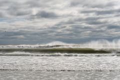 Moody day at the beach. Pounding  surf and white spray shooting up on North Carolina coast Royalty Free Stock Photos