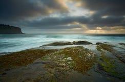Moody day over Bilgola rockshelf Australia Royalty Free Stock Photography