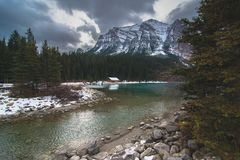 A moody day over Lake Louise in Banff over the famous boat house stock image