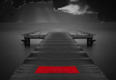 Moody empty jetty with red mat Stock Photo