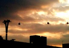 Moody evening sky with the Emirates Sky Way cable car Stock Photography