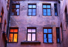 moody evening yard of vintage old town house Stock Photos