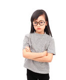 Moody girl. Asian girl moody emotion with arms folded isolated on a white background Stock Image