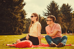 Moody girl with boyfriend in park. Love romance heartbreak concept. Moody girl with boyfriend in park. Lady upset on her man royalty free stock images