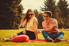 Moody girl with boyfriend in park. Stock Image